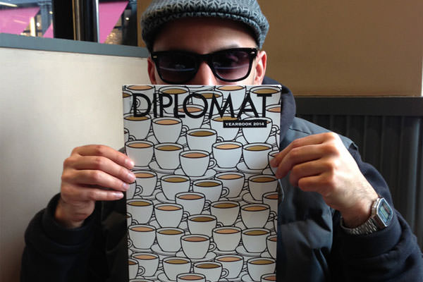 Pins designs the front cover for the Diplomat 2014 yearbook